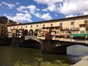 "Walking across this bridge, you will find wall to wall jewelry stores . . . Ponte Vecchio means the ""Old Bridge"", but often people call it the ""Gold Bridge""."